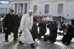 Pope passes news photographers as he arrives to lead general audience in St. Peter's Square at Vatican
