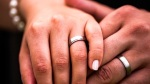 Closeup-of-hands-of-bridal-couple-with-wedding-rings-Shutterstock[1]