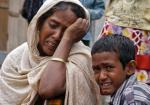 Villagers from Muslim communities affected by ethnic violence weep at a relief camp in Narayanguri village in Baksa district in the northeastern Indian state of Assam
