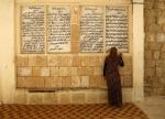 yazidi-woman-worships[1]