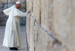 Pope Francis touches the stones of the Western Wall, Judaism's holiest prayer site, in Jerusalem's Old City on May 26, 2014. Photo courtesy of REUTERS/Andrew Medichini/Pool
